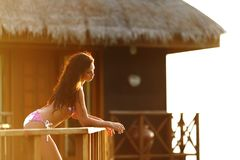Woman near tropical hotel Stock Photography