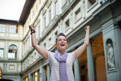 Woman near uffizi gallery rejoicing in florence Stock Photos