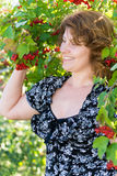 Woman near viburnum with mature berries Stock Image