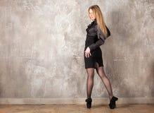 Woman near the wall Stock Image