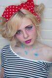 Woman near wall. Professional modern make-up. Pinup style Royalty Free Stock Photo