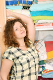 Woman near wardrobe with bed linen Royalty Free Stock Image