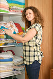 Woman near wardrobe with bed linen Royalty Free Stock Photos