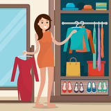 Woman near wardrobe for cloths with mirror. Royalty Free Stock Photo
