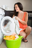 Woman near washing machine Royalty Free Stock Image
