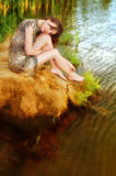 Woman near water Royalty Free Stock Photo