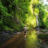 Woman near waterfall on Bali, Indonesia stock photos