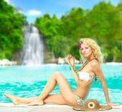 Woman near waterfall royalty free stock image