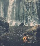 Woman near waterfall, Phnom Koulen at Siem Reap, Cambodia Royalty Free Stock Images