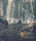 Woman near waterfall, Phnom Koulen at Siem Reap, Cambodia Royalty Free Stock Images