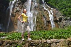 Woman near  waterfalls Stock Photo