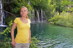 Woman near  waterfalls Stock Images