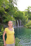 Woman near  waterfalls Royalty Free Stock Photography
