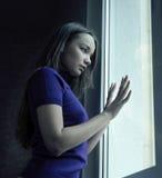 Woman near window Stock Images