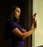 Woman near window Royalty Free Stock Image