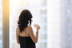 Woman near the window with a cup Royalty Free Stock Image