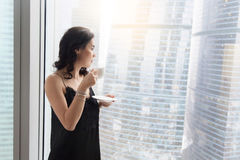 Woman near the window Royalty Free Stock Image