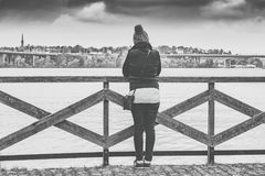 Woman Near Wooden Railing and Body of Water Grayscale Photo Royalty Free Stock Photography