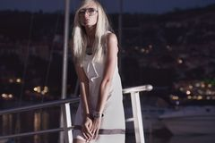 Woman near the yachts. Attractive young woman near the yachts Stock Photography