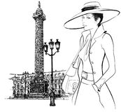 Woman nearby Vendome column in Paris Royalty Free Stock Photography