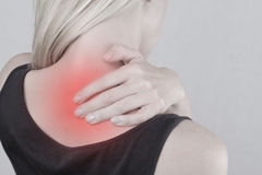Woman with neck and back pain. Woman rubbing his painful back close up. Pain relief concept Royalty Free Stock Image