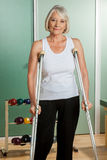 Woman with a neck brace using crutches Stock Photos