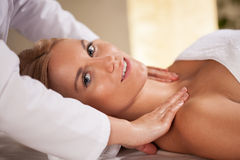 Woman during neck massage Royalty Free Stock Photography