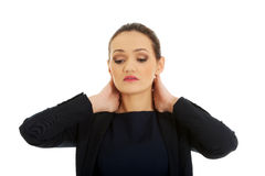 Woman with neck pain. Royalty Free Stock Images