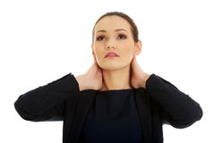 Woman with neck pain. Royalty Free Stock Image