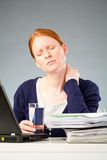 Woman with Neck Pain at Work Stock Photo