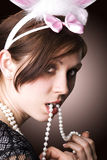 Woman with necklace. The beautiful woman with necklace from pearls in mouth stock photography