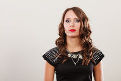 Woman with necklace in black evening dress Royalty Free Stock Photography