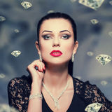 Woman with necklace and bracelet and earrings vintage style Royalty Free Stock Images
