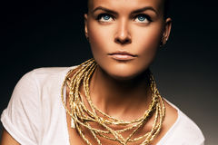 Woman with necklace of gold rope Stock Photography
