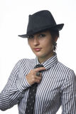 Woman with necktie and hat Stock Images
