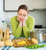 Woman needs to make dinner Stock Photography