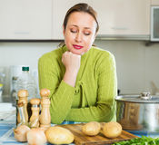 Woman needs to make dinner Royalty Free Stock Photography