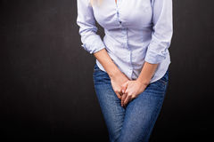 Woman needs to pee Royalty Free Stock Image