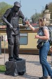 Woman nervously links fingers with living statue. Stratford upon Avon Warwickshire England UK April 21st 2018 Shakespeares Birthday celebrations and living Royalty Free Stock Image