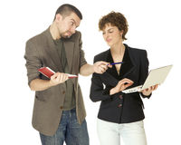Woman with netbooks and man with notebook Royalty Free Stock Images