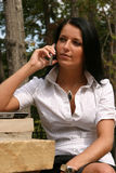 Woman networking. Young woman using cell phone to network Stock Photo