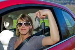 Woman with new car. Red Stock Photo