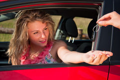 Woman with new car and car keys Stock Photography
