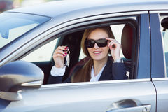 Woman in the new car with keys Royalty Free Stock Photography