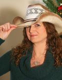 A Woman with a New Cowboy Hat Royalty Free Stock Photos