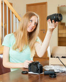 Woman with new digital camera at home Stock Photos