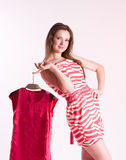 Woman with new dresses Stock Photography
