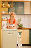 Woman with new kitchen appliance. Reading instructions stock image