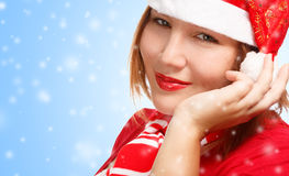 Woman in new year or christmas suit making a wish. Young woman in new year or christmas suit smiling on blue background and making a wish. Close up Stock Image