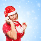 Woman in new year or christmas suit smiling on background with s Royalty Free Stock Photography